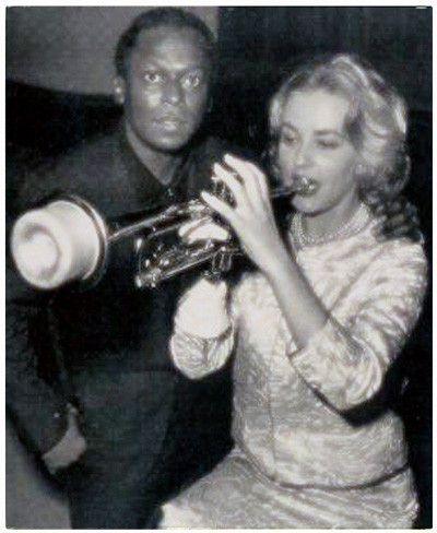 Jazz musician Miles Davis and actress Jeanne Moreau - trumpeting in a version of WordPress :)